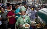 Zafar serves food from his food cart, Bangladesh. Photo: Abbie Trayler-Smith / Concern Worldwide.