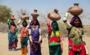 Women of Cheel Bandh village, (From Right to Left) Lachmi, Kareema, Radha, Kanta and Devi Umerkot district, on their way to the well to fetch water for their homes. Photo: Sharjeel Arif / Concern Worldwide