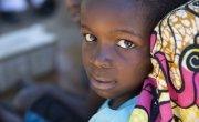 Mujinda Joseph (5) and the foot of his father Yumba Kalofando Banjamin in Tanganyika, DRC. Photo: Concern Worldwide.
