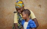 Clotilde Ndayisenga (25) with her daughter Arlene Akimana (2) at their home in Rugombo, Cibitoke. Photo: Abbie Trayler-Smith/Concern Worldwide.