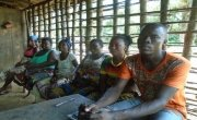 Soloman Tarr, sitting on the right alongside other members of the Gueh Town CSLA. Photo: Sam Holder / Concern Worldwide.