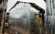 Residents rebuild their homes at the Kroo Bay slum.