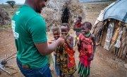 Concern staff pictured with children in Kenya