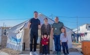 Michael Darragh Macauley visiting father Hassan and Mother Amal with their 2 sons, Amez (7) and Hevi (3) in a refugee camp in northwest Iraq. Photo: Gavin Douglas/Concern Worldwide.