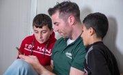 Michael Darragh Macauley meets Roman* and Mahma* at an Iraq refugee camp.