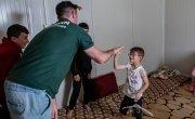 Michael Darragh Macauley meets with children living at an Iraq refugee camp.