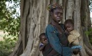 Marie Mbendu (40) with 15-month-old twins Dorcas, in her arms, and Moise, on her back. Photo: Chris de Bode.