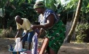 Amadu Kamara doing laundry with his wife Mariatu Sesay. Photo: Concern Worldwide.