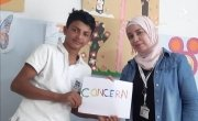 Samer* (14) with a Concern PSS facilitator at the Concern Protection Hub. Photo: Concern Worldwide.