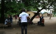 Concern's Learning Coach Mohamed Gobril Sesay raising awareness on COVID-19.