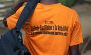 Andrew from Liberia proudly sporting his 16 Days of Activism t-shirt.