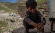 Asad* (6) washes her hands at the newly installed water station.Photo: Stefanie Glinski / Concern Worldwide