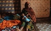 Aminata Abdoulaye (20) and her son Hassane (9 months). They live in the Lacouroussou District. Aminata is married to Agali, a motorcycle taxi driver. They have three children. Photo: Ollivier Girard / Concern Worldwide