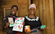 Juanita Kamwana and her daughter Jessie hold soap and Covid-19 fliers.