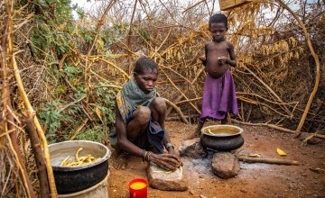 A family in Kenya prepare wild fruits for a meal.