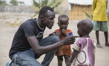 John Deng of South Sudanese NGO, Nile Hope, with some children on the island of Touchriak in Unity State. People have been hiding on the islands from fighting.