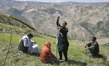 Setting measuring posts to gauge land slippage on a hillside in Yawan. Photo: Kieran McConville / Concern Worldwide.