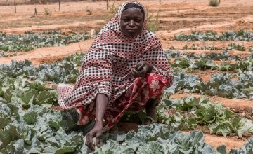 Chawada Aboubacar, Community Health Volunteer, with her 'sac potagé' – the vegetable garden she has grown with the support of Concern. Photo: Apsatou Bagaya / Concern Worldwide.