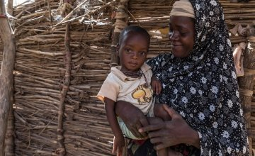 Rouaya with her son Salouhou at their home. Salouhou has just been admitted into Concern's nutrition programme and has started treatment for Severe Acute Malnutrition. Photo: Apsatou Bagaya / Concern Worldwide.