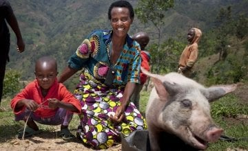 Violette Bukeyeneza (45) and her son Lievain Irankunda 3 (M) with the pig she has bought from the profits of her business at her home in Bukinanyana, Cibitoke, Burundi. Photo: Abbie Trayler-Smith / Concern Worldwide.