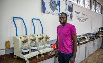 Steve Osumba, a Project Engineer at Maker Space, explaining their suction machine design process.