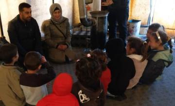 Concern staff deliver a hygiene promotion session to children in Syria, 2019