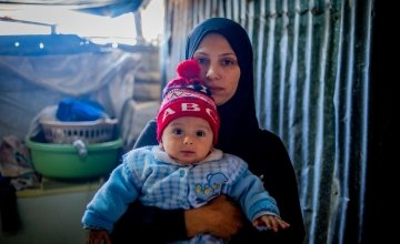 A Syrian woman pictured with her baby.