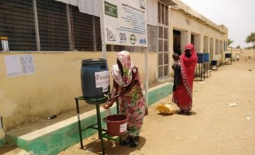To help reduce the spread of Covid-19 beneficiaries wash hands before entering Concern supported Nutrition Facility in West Darfur.