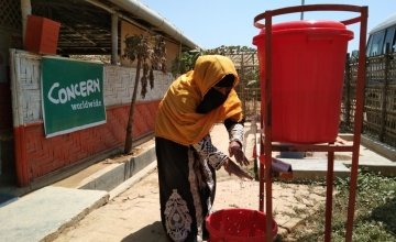 Kona, a Concern programme participant, washing her hands as a preventative measure to the spread of COVID-19