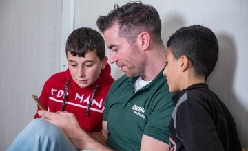 Dublin footballer Michael Darragh Macauley with two Syrian boys in Iraq where he visisted refugees being helped by Concern Worldwide in November 2019. Photo by Gavin Douglas of Concern Worldwide