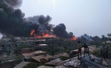 View from nearby homes of a fire in Cox's Bazaar in March 2021