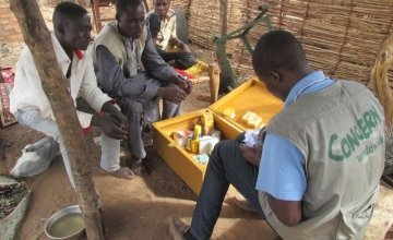 Concern livestock officer taking records of the veterinary kit stock in Sila, Chad, May 2017. Photo: Cecilia Benda / Concern Worldwide.
