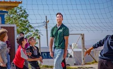 Dublin footballer Michael Darragh Macauley playing volleyball with Syrian children in Iraq