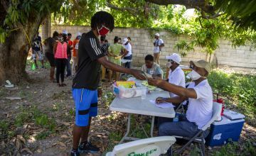 Residents line up during a distribution in Port-au-Prince, Haiti.