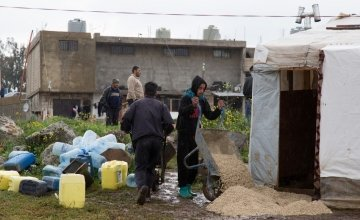 Building materials provided by Concern Worldwide help Syrian refugees in northern Lebanon to prepare their shelters for winter. Photo: Dalia Khamissy / Concern Worldwide.