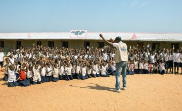 Concern WASH project manager speaks to a school in Mande about good hygiene practices. Photo: Concern Worldwide.