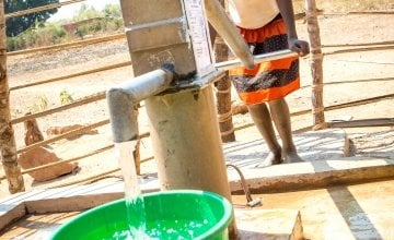 Mbugu Feza fetches water at the water pump in the Luba village, constructed with the support of Concern Worldwide within the framework of the DRC WASH. Photo: Concern Worldwide.