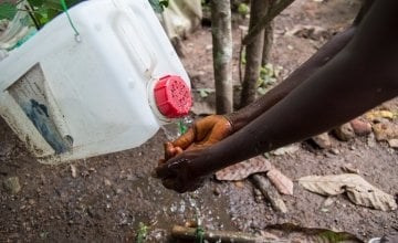 A tippy-tap in action in the village of Dokoizia in Lofa county, Liberia. Photograph taken by: Kieran McConvillle/Concern Worldwide.