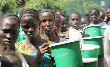 Nyakim Wiyual, Nyachuol Ruot, Nyamal Deng are amongst those attending a food distribution at one of Concern's nutrition centre's in Pugnido Camp 1, Gambella, Ethiopia. Photo: Jennifer Nolan / Concern Worldwide