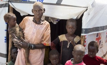 """Puru Wani and 14 of her extended family fled their village on the outskirts of Juba when fighting broke out in July. Now they are staying in two small shelters at a protection of civilians site beside the UN base in Juba. """"Our village is destroyed. Everything was looted - there is nothing to go back to,"""" she says, """"and If we did go back we would be killed."""""""