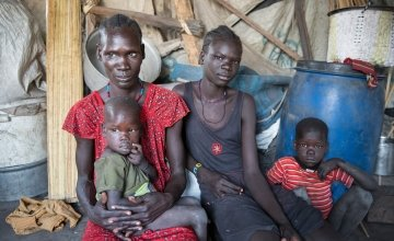 37 year old *Sahra, with two of her five children, outside their temporary shelter in the swamps of Unity State, South Sudan. She came here to flee fighting in her home town. Photo: Concern Worldwide.