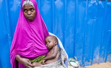 Ayaan* (28) with her three year old son, Aadan*, at Concern Worldwide's nutrition centre in Mogadishu, Somalia. Photo: Kieran McConville, March 2017.