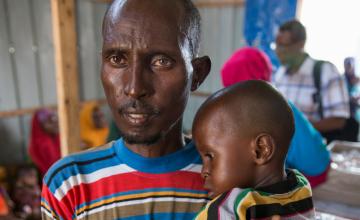 Abdullahi* with his son, Abhsir* (4), at a nutrition centre run by Concern Worldwide in Mogadishu in Somalia. Photo: Kieran McConville, March 2017.
