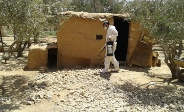 Member of the Concern team in Syria spraying a building in order to control the spread of pests and insects. The bombing of buildings and the breakdown of municipal systems has resulted in a build-up of dust and dirt for pests to thrive in. Photo: Concern Worldwide.