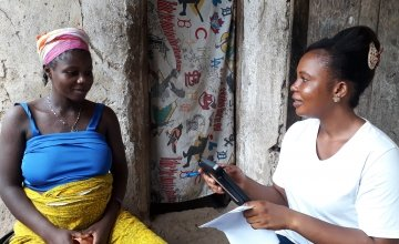 Data collector, Mariama Kamara, completing a household survey in Tonkolili district. Photo: Carlos Velazquez / Concern Worldwide