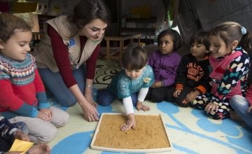 Concern Worldwide education officer, Nour Al Hajal, with a group of children attending a non-formal education programme that focuses on early childhood education in northern Lebanon. Photo: Chantale Fahmi/Concern Worldwide 2017.