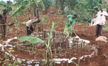 Odette Kanziza, along with family members, prepares her kitchen garden which was constructed with thanks to a generous $100 (€95) public donation. Photo: Concern Worldwide.