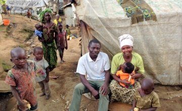 Edmond Matembe and his wife in front of their hut in Kilmani camp. Photo by Silvia de Faveri/Concern Worldwide.