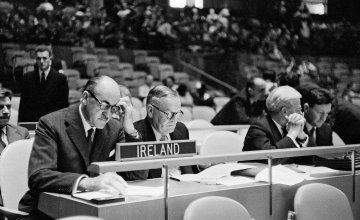 Frank Aiken, Ireland's Minister for External Affairs, and Chairman of the Delegation of Ireland to the General Assembly (left), at his country's desk, with Mr. Frederick H. Boland, Permanent Representative of Ireland to the U.N., photographed prior to the opening of the afternoon meeting of the Assembly in September 1957. Photo: UN Photo Library.