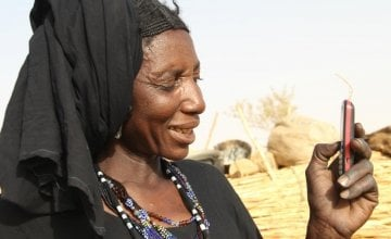 Gaichatou uses her mobile phone as part of the Concern cash transfer program in Niger. Photo taken by Tagaza Djibo/Concern Worldwide.